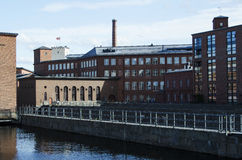 Old factory's buildings region by the river, Finland Stock Photo