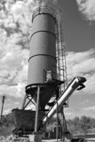 Old factory sand tank. Black and white scenic view of old sand tank or tower, part of industrial factory royalty free stock photo