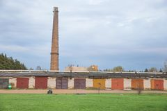 Old factory tower and garages, urban city view. Travel photo 2018. City Jekabpils, Latvia. Old factory tower and garages, urban city view. Travel photo 2018 stock photography