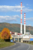 Old factory with two high chimneys. Next to the route Royalty Free Stock Images