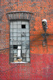 Old factory wall with window. The old architecture of Saint Petersburg city, Russia Royalty Free Stock Photo