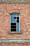 Old factory window with broken glass Royalty Free Stock Image