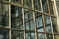 Old factory windows, dirty broken Stock Image