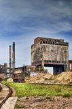 Old factory. Ironworks with chimney in countryside, very old Stock Image