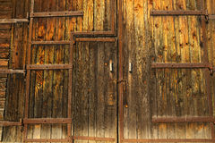 Old faded gate/doors. Old wooden gate faded by sun with chain Royalty Free Stock Image