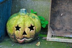 Old faded halloween pumpkin. And an old wooden crate Stock Photos