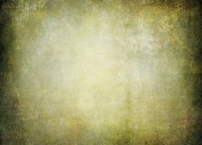 Old faded parchment in brown beige bluish tones Royalty Free Stock Photos