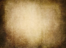 Old faded parchment in brown beige sepia tones Stock Image