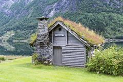 Old fairytale like house of wood with chimney of stacked slate Stock Photo