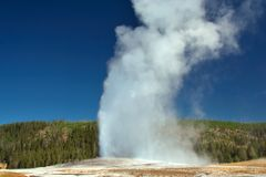 Old Faithful. Geyser site in Yellowstone Park stock images