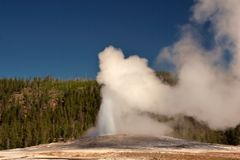 Old Faithful. Geyser site in Yellowstone Park royalty free stock photo
