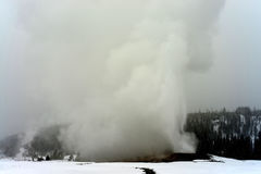 Old Faithful Geothermal geyser Yellowstone Wyoming Stock Images