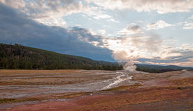 Old Faithful Geyser at dawn as seen from the Old Faithful Inn in Yellowstone National Park in Wyoming Royalty Free Stock Photos