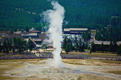 Old Faithful Geyser. Water and steam a erupting as onlookers observe old Faithful Geyser stock photography