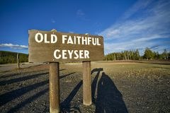 Old Faithful Geyser. Wood Sign - Famous  in the Yellowstone National Park, Wyoming, USA stock photos