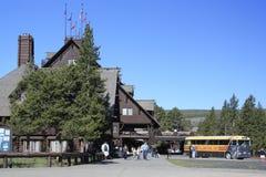 Old Faithful Inn and Bus. View of Old Faithful Inn in Yellowstone Park stock image