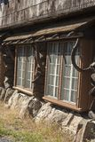Old Faithful Inn exterior windows. Old Faithful Inn exterior near the famous geyser attraction in Yellowstone known for its hot-water eruptions on a consistent royalty free stock photo