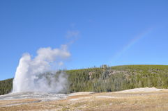 Old Faithful and Rainbow Royalty Free Stock Photos