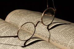 Old Family Bible. With eyeglasses Stock Image