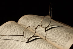 Old Family Bible. With eyeglasses Royalty Free Stock Photo