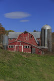 Old Family Farm Vermont. An old red barn and silo of a family farm in Vermont Royalty Free Stock Image
