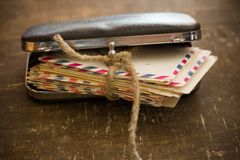 Old family letters in a retro hand bag stock images