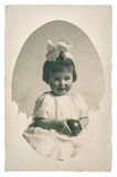 Old family photo portrait of little girl with toy ball Stock Photography