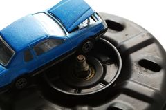 Old fan motor unit scene. The used and damaged old fan motor unit with model toy car put beside represent the car part and maintenance concept related idea stock photo