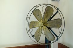 Old fan placed in the corner. stock image