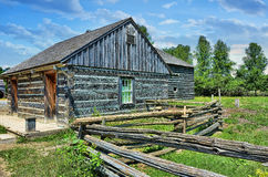 Old farm. Old weathered blue farm building , typical style of north america 1860 Stock Photos