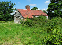 Old farm building with rusty tin roof Royalty Free Stock Photo