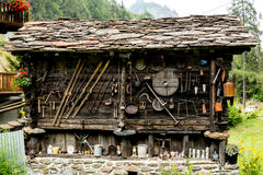 Old farm building with vintage paraphernalia. Vintage wooden house royalty free stock images