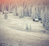 Old farm in the Carpathian mountains. Colorful winter morning. Royalty Free Stock Photos