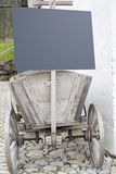 Old farm cart with information panel Stock Photo