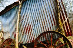 Old farm cart rusts in the field royalty free stock image