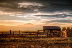 Old Farm in the Country. An old farm and cattle ranch in the country during sunset Royalty Free Stock Images