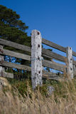 Old farm fence on blue sky background Stock Photo