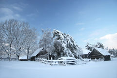 Old farm in the forest at winter Royalty Free Stock Image