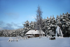 Old farm in the forest at winter Stock Photography
