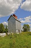 Old farm grain elevator Stock Photography