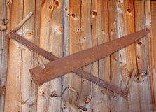 Old farm hand tools on wall as decoration Stock Photos