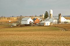 Old Farm Homestead in Late Fal. Old farm buildings with silos on the fertile farming land of Lancaster County, Pennsylvania in late fall stock images