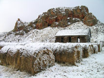 Old Farm House. Snow-covered Hay Bales and Old Farm House Stock Photography