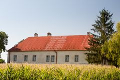 Old farm house in the field Stock Photo