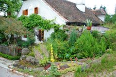 Old farm house with romantic garden Stock Images