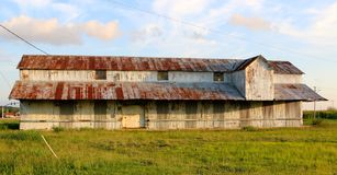 Old Farm House With Rustic Rusty Roof In The Mississippi Delta. An Old Long Farm House with rustic rusty roof, plenty of these old rustic farmhouses dot the stock photography