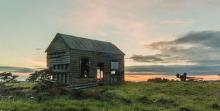 Old Farm House. Small old farm house just rotting away, with a morning sky bind it Stock Images