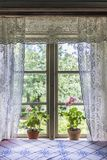 Old farm house window with lace curtains stock images