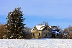 Old farm house in Winter. Old abandoned farm house in a frosty winter wonderland Stock Image