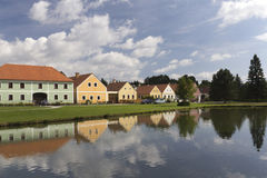 The old farm houses and pond. Rural decorated houses in Zabori, Czech Republic. UNESCO World Heritage Site in South Bohemia Stock Images